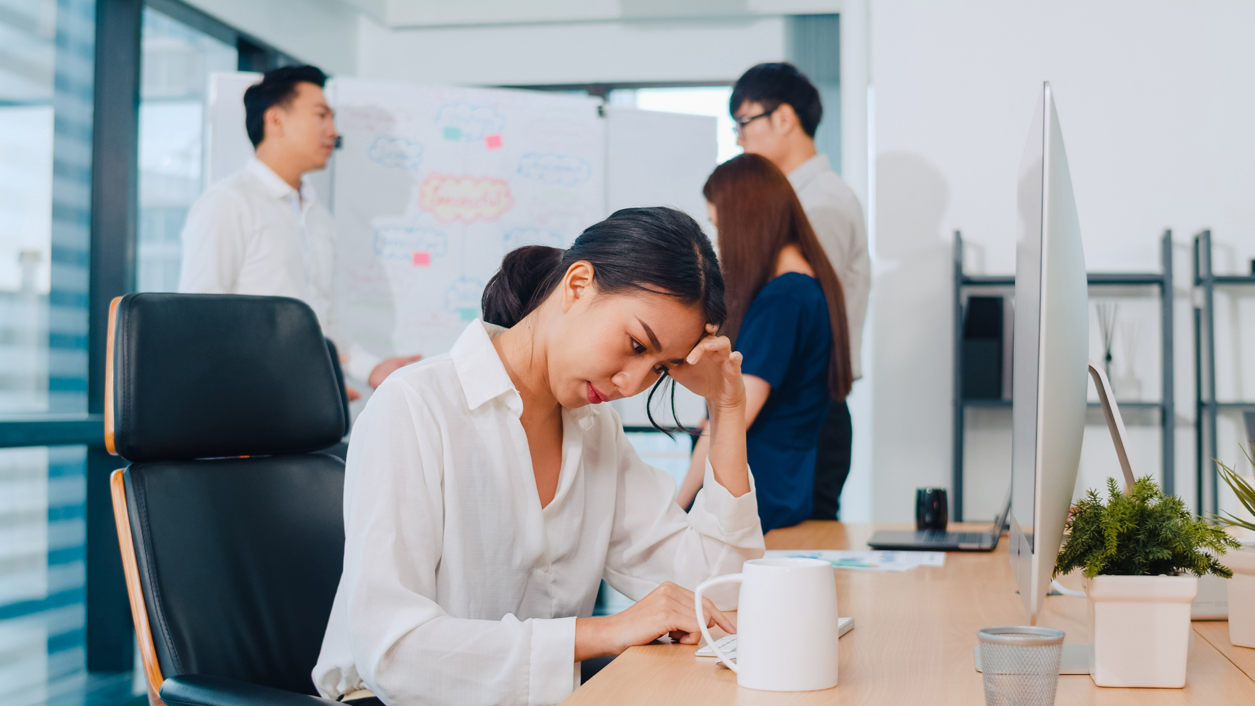 Millennial young Chinese businesswoman working stress out with p